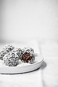 Chocolate coconut energy balls rolled in coconut