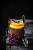 Blended chocolate chia pudding with orange and pomegranate