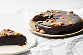 Brownie cake with salted caramel and roasted peanuts