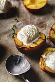 Melting vanilla ice cream served in hot grilled halved peaches and nectarines