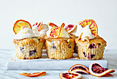 Blood orange and blueberry iced cupcakes