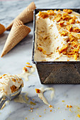 Honeycomb icing with waffle cones and scoop