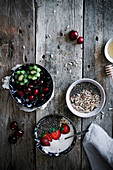 Healthy yoghurt, chia and fruit for breakfast, on a rustic kitchen table