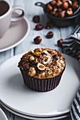 Hazelnut muffins on white background