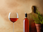 Glass of rose wine in a warm, tuscan kitchen setting