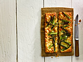 A puff pastry tart with cheese and green asparagus (Wales)