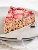 Slice of a strawberry upside-down cake, gluten and sugar free