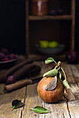 An autumn pear on a rustic wooden background