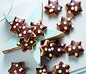 Nut stars with dark chocolate, filled with currant jelly