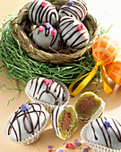 Pistachio and marzipan eggs filled with nougat for Easter