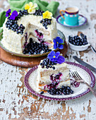 A white chocolate and blueberry cake