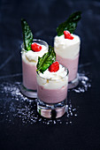 Strawberry shakes with cream served in glasses