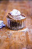 Poppyseed bake with port wine cream in a small glass ramekin
