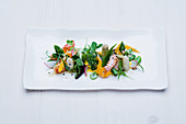 Cray fish with white asparagus with vegetables