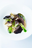 Braised artichokes with salanova lettuce and truffle