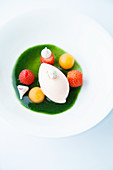 Melon sorbet on mint coulis