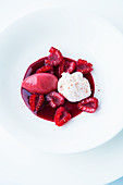 Raspberry sorbet with cream cheese and beetroot coulis