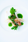 Roasted black salsify with parsley oil and Parmesan