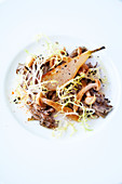 Cauliflower fungus with pears and frisée lettuce