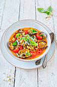 Mussel soup with semolina Fregola pasta and tomatoes, Sardinia