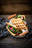 Vegan waffle sandwiches with grilled almond cheese, chard, cucumbers and radishes
