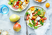 Panzanella salad with mozzarella, toasted baguette, tomatoes and plums