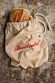 Wholemeal organic bread in a linen bread bag