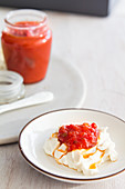 Red pepper jelly over cream cheesse