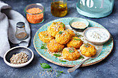 Red lentils, courgette and feta fritters