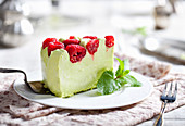 Pistachio mousse cake, cheesecake with fresh raspberry
