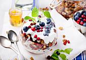 Healthy breakfast. Granola with berries, honey, yogurt and fresh berries