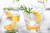 Gin, lemon, rosemary fizz, cocktail with honey and fresh herbs