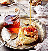 Cinnamon bun rolls with syrup and tea