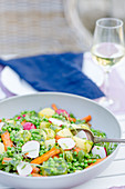 Potato salad with arugula, radishes, peas and pesto
