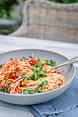Spaghetti with rocket, peppers, tomatoes and zucchini