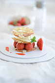 Almond biscuits with strawberries and honey cream
