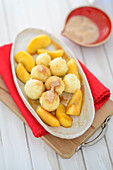 Semolina dumplings with apple slices