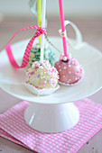Colourful cake pops decorated with sugar sprinkles