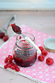 Redcurrant and raspberry jam with sour cherries