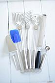 Mixing spoons, a spatula, a melon baller, a grater, and a cake slice
