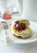 Scone with clotted cream and strawberry jam