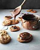 Cookies being drizzled with chocolate