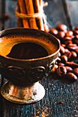 Cup of turkish coffee with sugar and cinnamon