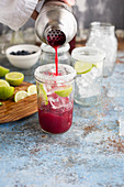 Margaritas with blueberry juice and lime