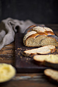 Braided bread with poppy seeds and sesame seeds, sliced