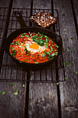 Tomato shakshuka in a pan (egg dish, North Africa)