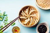 Gyoza dumplings with duck cooked in bamboo steamer