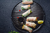 Vegan spring rolls with tofu, marinated carrot and daikon