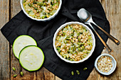 Zucchini with oatmeal, cheese and pumpkin seeds