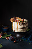 Spiced cake with cream cheese icing, apple crisps, fresh figs and toffee sauce